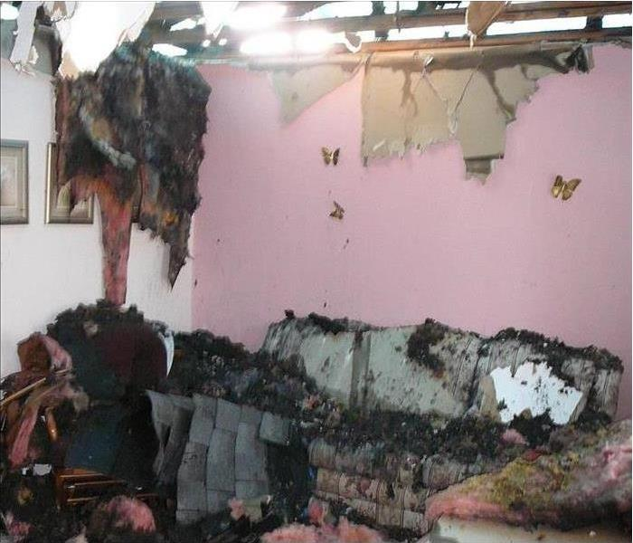 fire damaged room with caved in ceiling