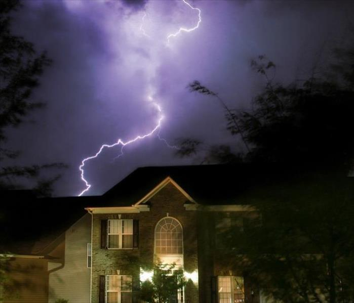 lightning striking a home at night